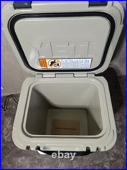 YETI Roadie 24 TAN Hard Cooler & Yeti Rambler COLSTER slim can insulator pink